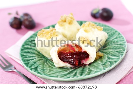 Delicious sweet dumplings stuffed with plums - stock photo