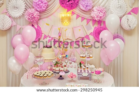 Delicious sweet holiday buffet with cupcakes, meringues and other desserts - stock photo
