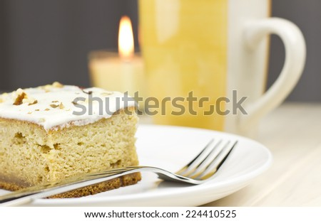 Delicious sweet pumpkin squash dessert cake  with coffee on wood table. - stock photo