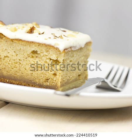 Delicious sweet pumpkin squash dessert cake  with fork on wood table. - stock photo