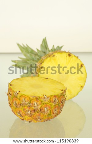 Delicious sweet ripe pineapple cut in half.