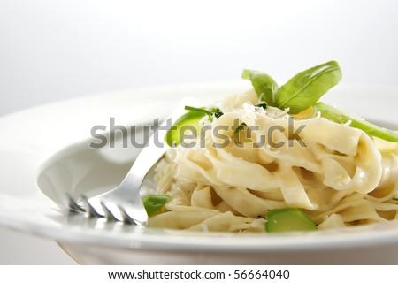 delicious tagliatelle with fresh broccolini in classic white sauce - stock photo