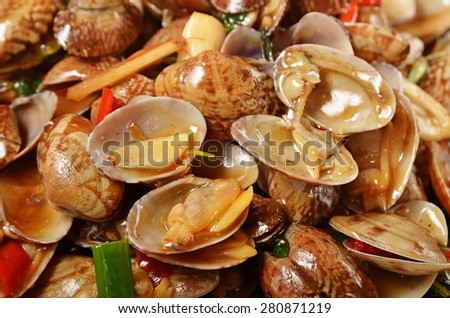Delicious Taiwan's seafood - Fried clams with basil    - stock photo