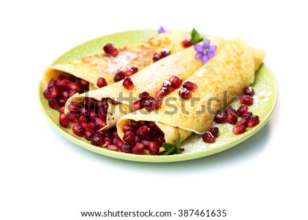 Delicious Tasty Homemade crepes with pomegranate - stock photo
