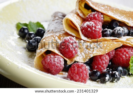 Delicious Tasty Homemade crepes with raspberries