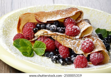 Delicious Tasty Homemade crepes with raspberries - stock photo
