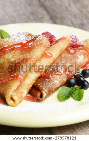 Delicious Tasty Homemade crepes with raspberries and blueberries - stock photo