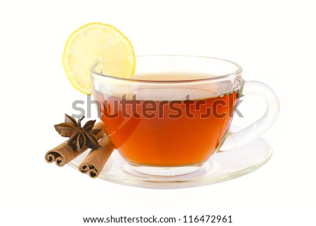 Delicious tea with spices and lemon in a glass cup isolated on white with clipping path - stock photo