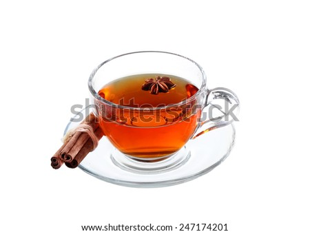 Delicious tea with spices in glass cup isolated on white background with clipping path - stock photo