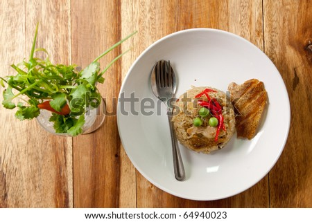 delicious thai food.fried rice with fish  wood background. Thai food.