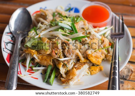 delicious Thai noodle shrimp with fry oyster shell, which is the popular food in Thailand - stock photo