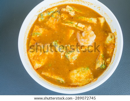 Delicious thai traditional food .Shrimp sour soup with fried egg made of tamarind paste.select focus. - stock photo
