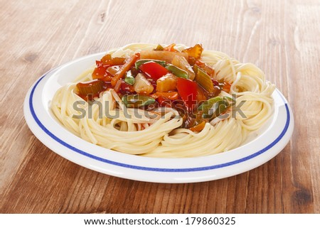 Delicious thai vegetarian pasta on white plate on wooden background. Healthy vegetarian eating.  - stock photo