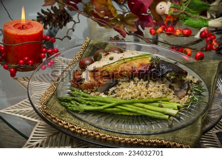 Delicious Thanksgiving turkey with rice and green asparagus  - stock photo