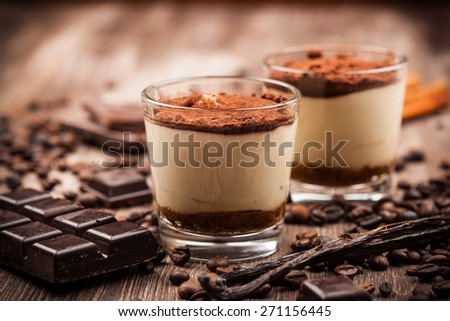 Delicious tiramisu dessert with ingredients - stock photo