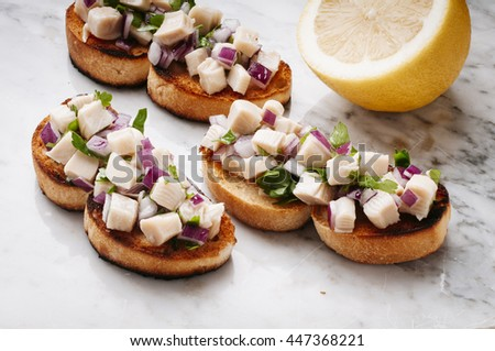 Delicious Toast with cuttlefish in Green Sauce - stock photo