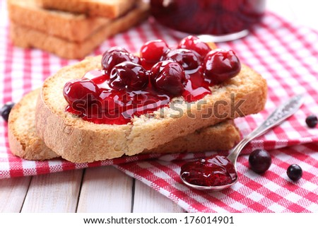 Delicious toast with jam on table close-up - stock photo