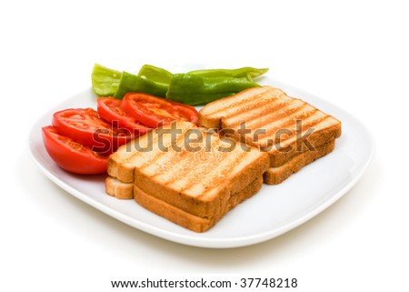 Delicious toasts with sliced tomatoes and green peppers isolated on white background. - stock photo