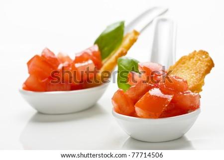 Delicious tomato bruschetta served in appetizer spoons - stock photo