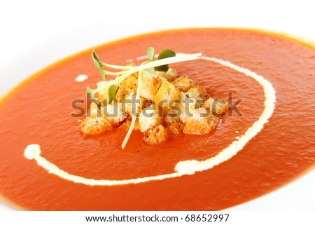 Delicious Tomato cream soup with crackers - stock photo