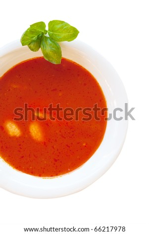 Delicious tomato soup with basil leaves and home made egg noodles. - stock photo