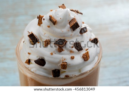 Delicious top of the chocolate milkshake. Caloric drink with cocoa, ice cream, milk and cookie crumbles. Favorite variant of popular refreshment. - stock photo