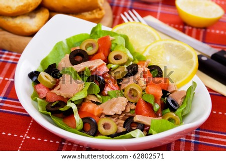 Delicious tuna salad with tomato, lettuce and sliced olives