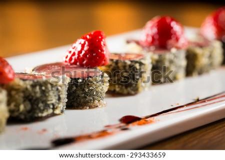 Delicious tuna tataki with strawberry and soy sauce. - stock photo