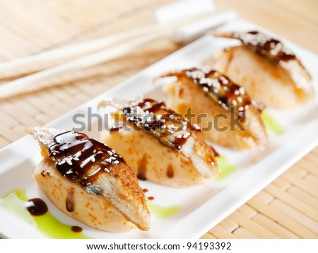 Delicious unagi meat with mashed potatoes and caviar - stock photo