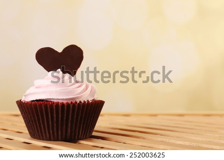 Delicious Valentine Day cupcake on light background - stock photo