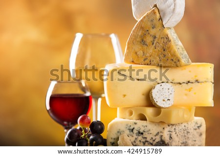 Delicious various cheese on old wooden table - stock photo