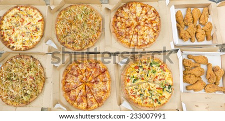 Delicious various kinds of pizza and fried chicken - stock photo