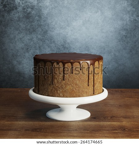 Delicious vegan chocolate cake on wooden surface behind grey wall  - stock photo