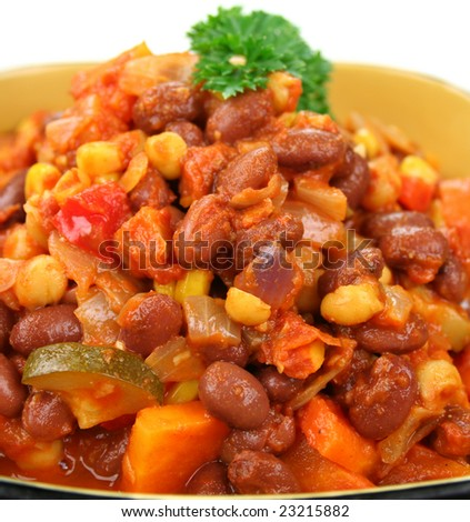 Delicious vegetable and lentil hot pot with a parsley garnish ready to serve. - stock photo