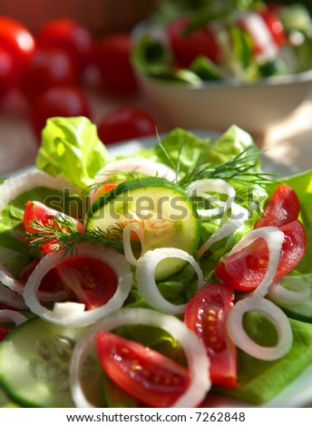Delicious vegetable salad with tomato, onion and cucumber