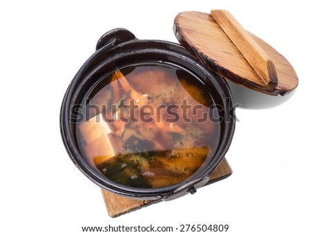 Delicious vegetable soup with tofu on old metal pot. Isolated on a white background.