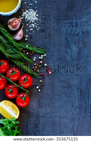Delicious vegetables ingredients and seasoning for healthy vegetarian cooking on dark vintage background. Diet or vegan food concept. Top view. Copy space. - stock photo