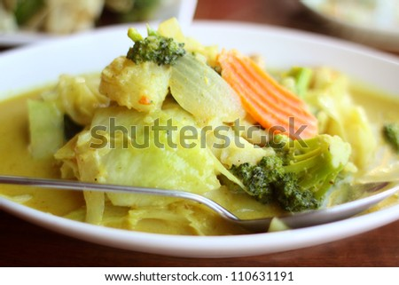 Delicious vegetarian dish with yellow curry at a Thai restaurant. - stock photo