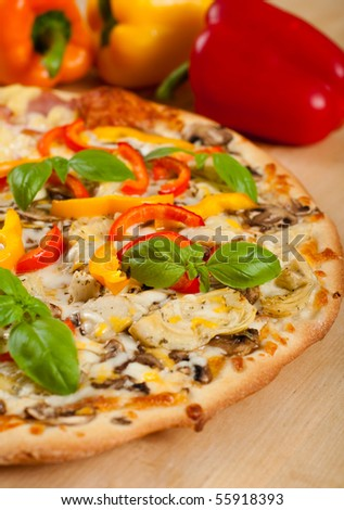 Delicious Vegetarian Pizza with Fresh Basil - stock photo