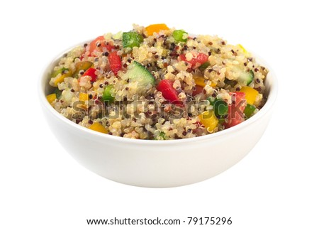 Delicious vegetarian quinoa salad with bell pepper, cucumber and tomatoes isolated on white (Selective Focus, Focus one third into the bowl) - stock photo