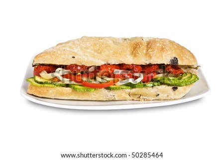 Delicious vegetarian sandwich in a ciabatta, Italian bread with zucchini, onion, red pepper and dried tomato. Isolated on white. It has a clipping path. - stock photo