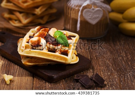 Delicious waffles with banana and chocolate - stock photo