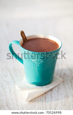 Delicious, warm hot chocolate in a turquoise mug - stock photo