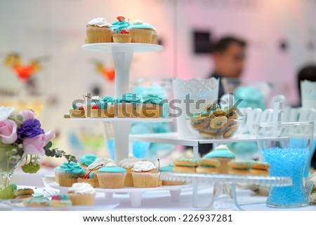 Delicious wedding blue sweet table - stock photo