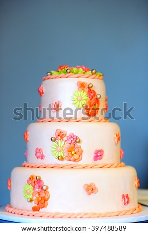 Delicious wedding cake decorated with sugar flowers  - stock photo