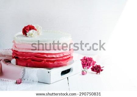 Delicious wedding cake decorated with with ribbon - stock photo
