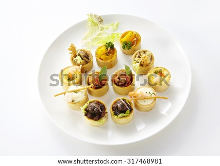 Delicious Western dishes on white background,Assorted savoury holiday snacks on plate  - stock photo