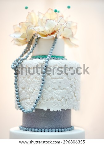Delicious white and grey wedding cake decorated with flowers  - stock photo