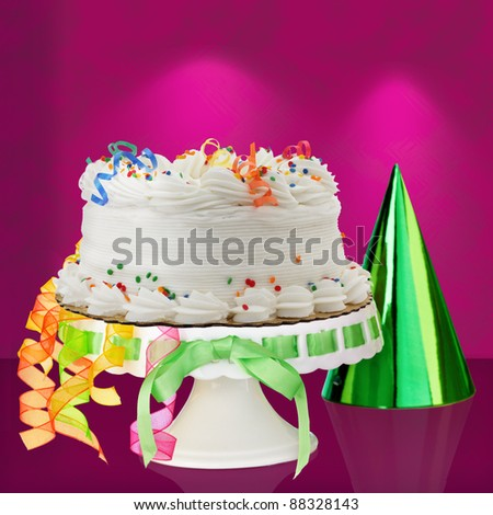 Delicious White Vanilla Birthday Cake With Red, Blue, Green, Yellow and Orange Confetti Decorations - stock photo