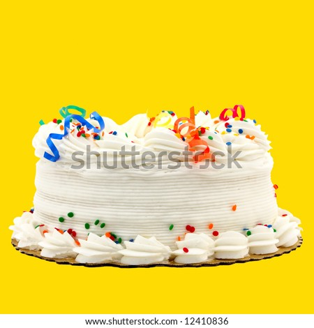 Delicious White Vanilla Birthday Cake With Red, Blue, Green, Yellow and Orange Decorations ~ Isolated On Yellow Background - stock photo